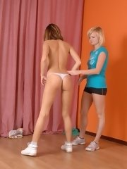 Sweet lesbian seduction at nude sports training