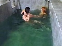 Two lezzies play with pussy in pool lesbian xxx