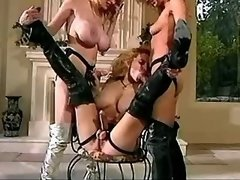 Four gorgeous lesbians in boots play with... lesbian xxx